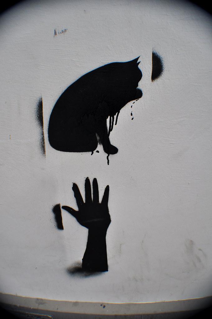 Chat noir et hand pochoir