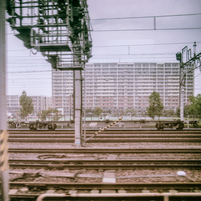 Apartment buildings on a train line from Narita to Tokyo