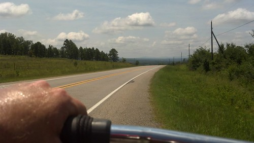 road cycling by under the skies of arkansas