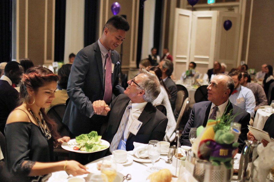 SF State alumni Sokhom Mao shakes hands with SF State Dean Don Taylor after Mao's speech during the5th annual Guardian Scholars Program Luncheon at the Sir Frances Drake Hotel on Oct 18. The Guardian Scholars Program is a SF State organization designed to help children in the foster care system transition into college life. Students in the Guardian Scholars Program have an 85 percent graduation rate. Photo by John Ornelas / Xpress