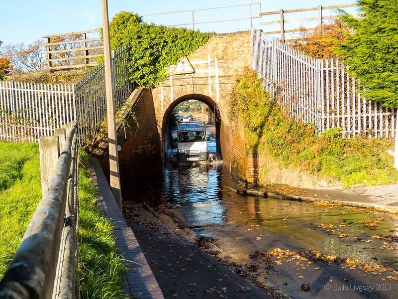 Flooding under the bridge on Whitecliff Road