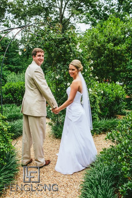 Bride and groom take portrait photos together after ceremony