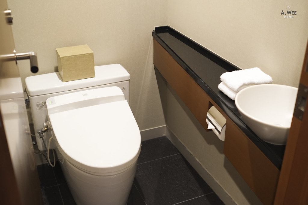 Toilet in separate chamber