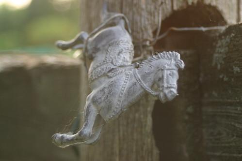 Horse trinket on fence