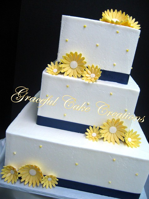 Simple Elegant White Butter Cream Wedding Cake With Yellow