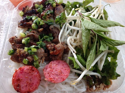 Vietnamese grilled pork on vermicelli noodles with vegetables and sour ham.
