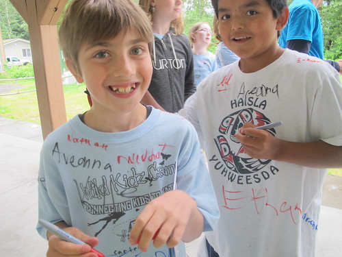 Kids sign each others' shirts