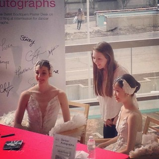 ballerinas signing autographs and posing for pictures