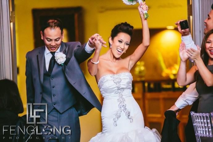 Vietnamese bride and groom make entrance to wedding reception