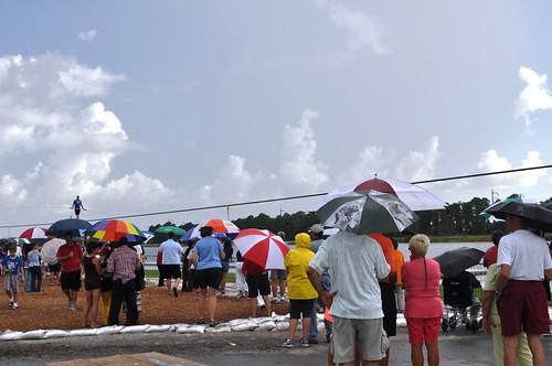 Devoted Nik Wallenda fans stick around in the rain at Nathan Benderson Park, Sarasota, June 19, 2013.
