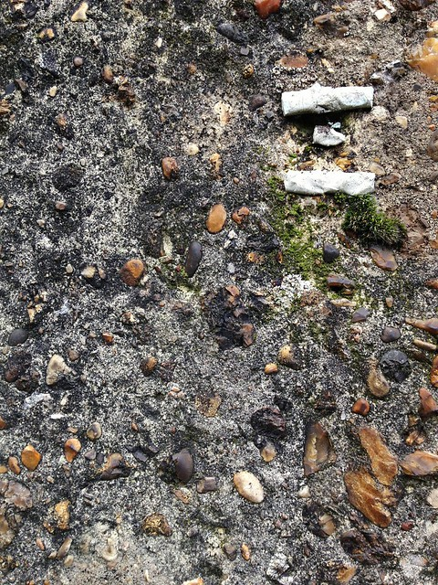 Raw concrete walls - good for holding used cigarette butts