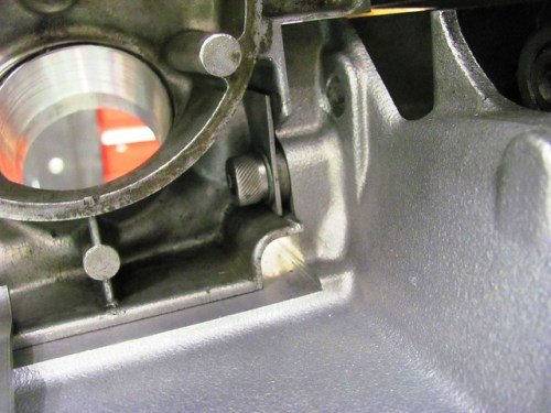 Left Air Box Cover Mounts Behind Strap on Top Left Transmission Bolt