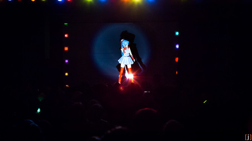 Yume, the official mascot of Synthesized Reality Productions, appears onstage at the start of the unofficial Vocaloid concert. Pacific Media Expo 2013. [j]