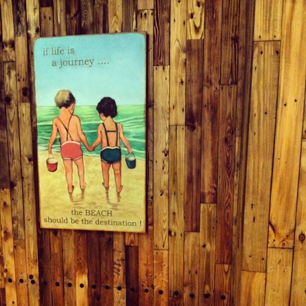 Two boys at a beach. Seen in a mall in Jakarta. #iseefreedom