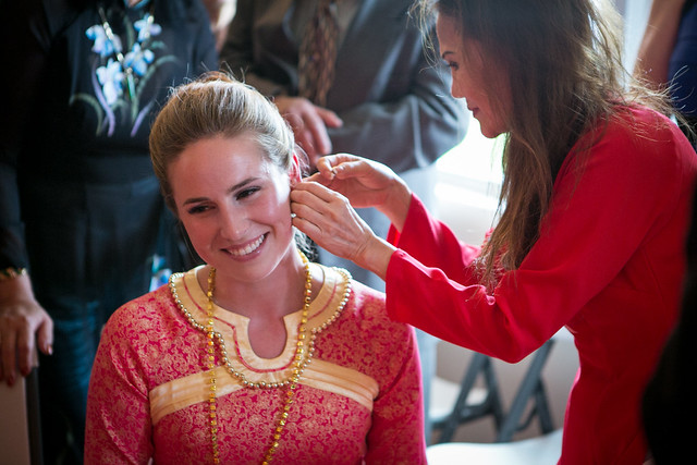 The groom's mother placing diamond earrings in my ear. Katarina Price Photography.