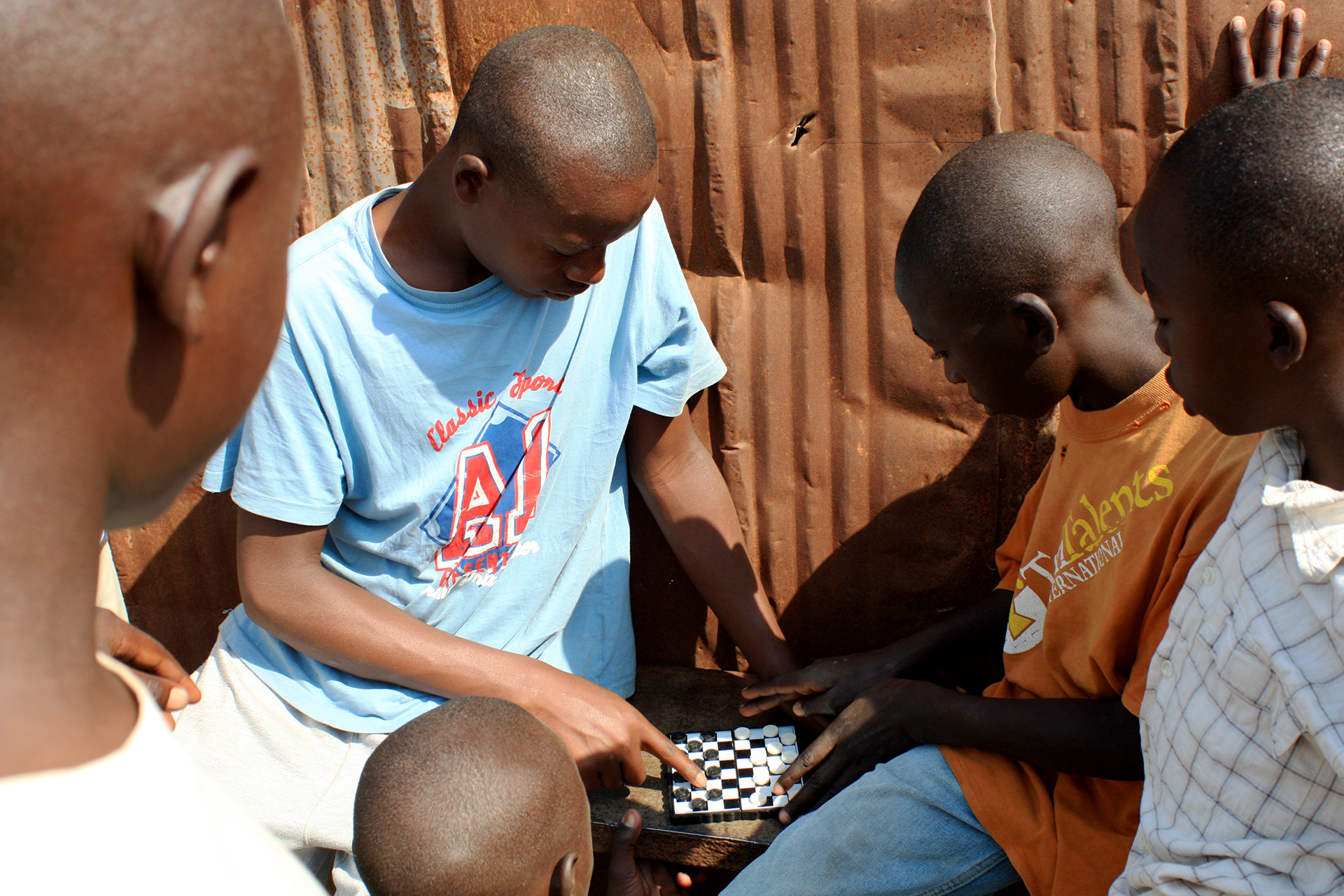 Neighbor boys playing checkers.
