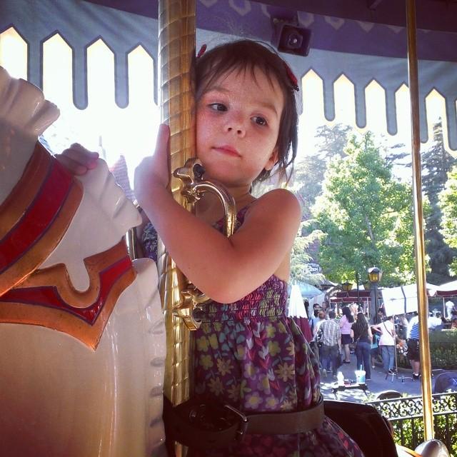 She loves this horse! She named her Lila.  #kingarthurscarousel #disneyland