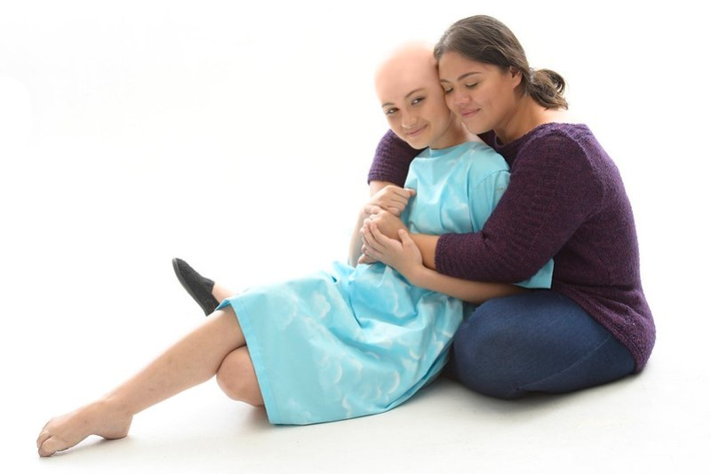 12.Dani Lyons (played by Rebecca Coates), embraced by her mother (played by Pamela Imperial at certain performances)