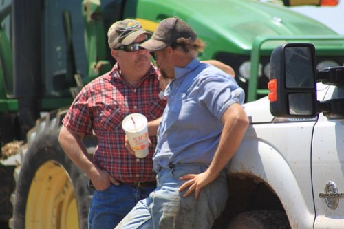 Dad and Farmer Mike, conversing.