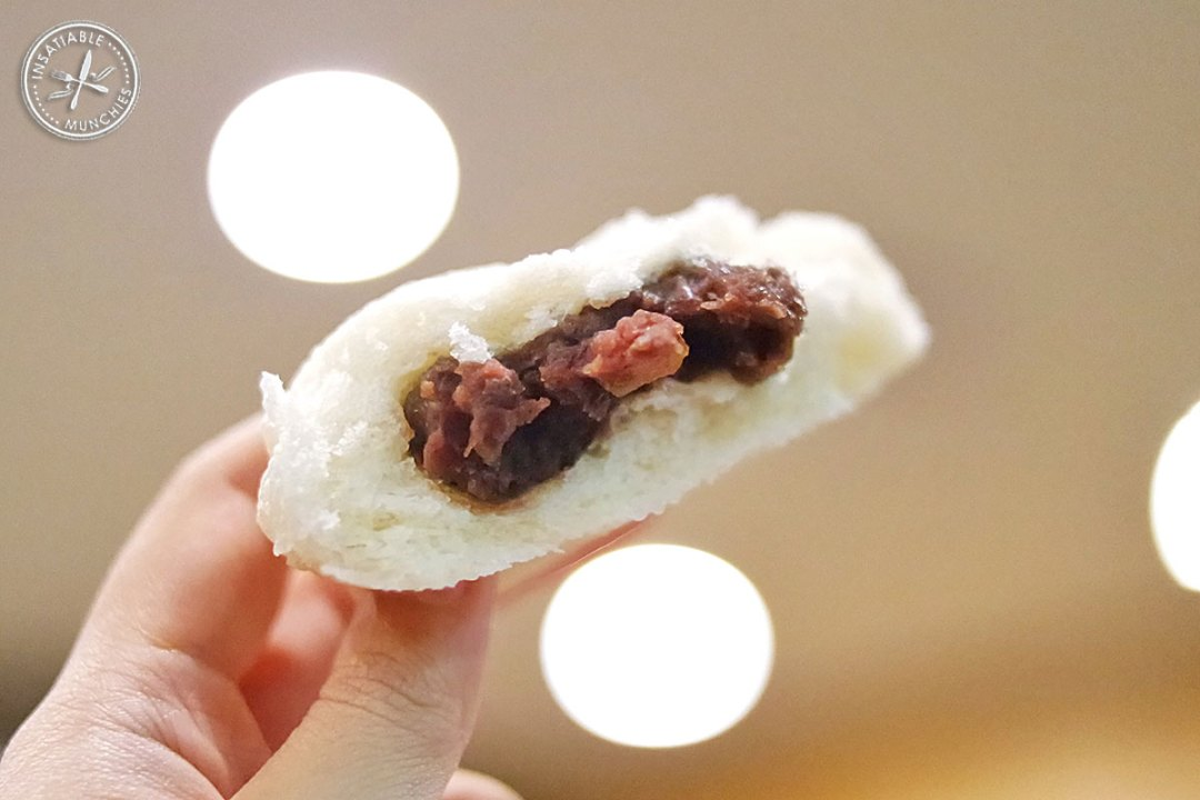 Sweet red bean paste is encased in fluffy white dough and steamed to create this red bean bun.