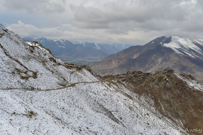 See those four tiny people on the path? They're walking to Lhasa from Ganden Monastery.