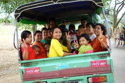 Burmese locals in back of truck, Myanmar