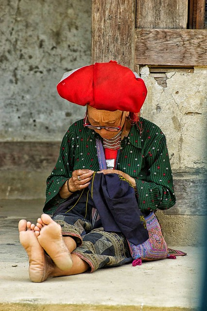 The lady intent on sewing