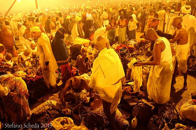 Pilgrims reading for the Mauni Amavasya Snan (Main sacred bath) at Kumbh Mela - Allahabad, India