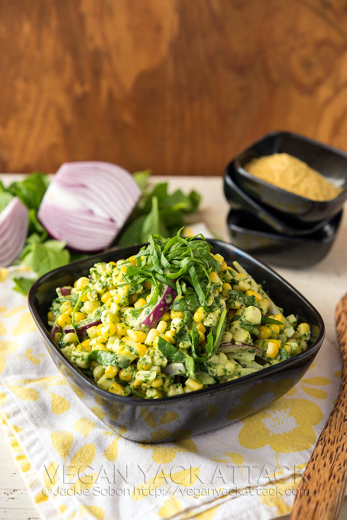 This Summer Corn Salad makes for a super tasty, vegan side that comes together in minutes! Corn + red onion + basil pesto aioli is a dreamy combination.