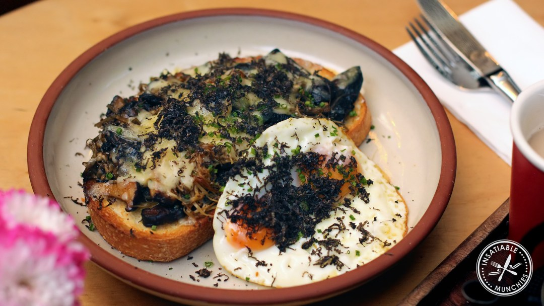 Ultimate toastie: mixed mushrooms laid on thick toasted sourdough, with melted cheese, and a side of sunny side up eggs. Topped with grated truffles.