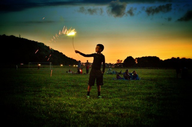 Son 2 holds a sparkler