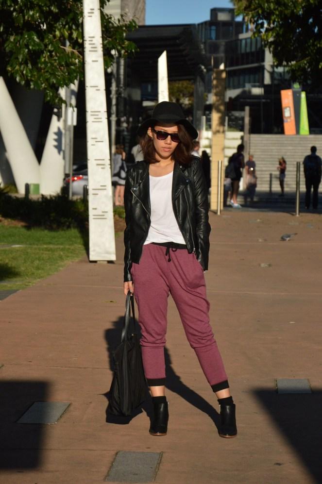 black leather jacket, black floppy hat, maroon sweatpants, black ankle boots