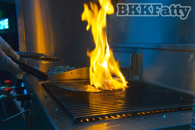 burger engulfed in flames street food bangkok