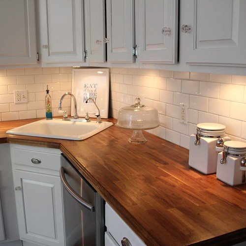 ikea kitchen counter facelift for cabinets butcher block counters 2 years later what do we think old it was a good experience as whole and i said re so happy to have removed that spray painted green laminate replaced with something more