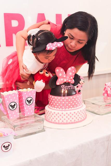 Sarah blows her birthday cake