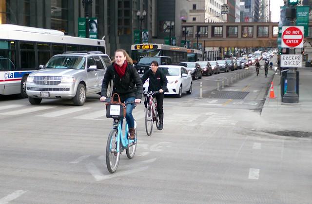 Woman using a Divvy bike (cropped)