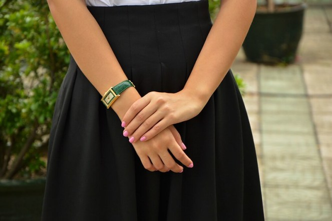 black midi skirt, vintage green gold gucci watch, pink matte nails