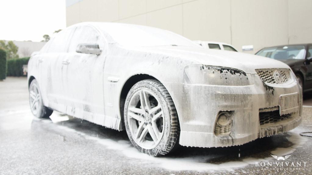 Holden SV6 undergoing snow foam pre-wash