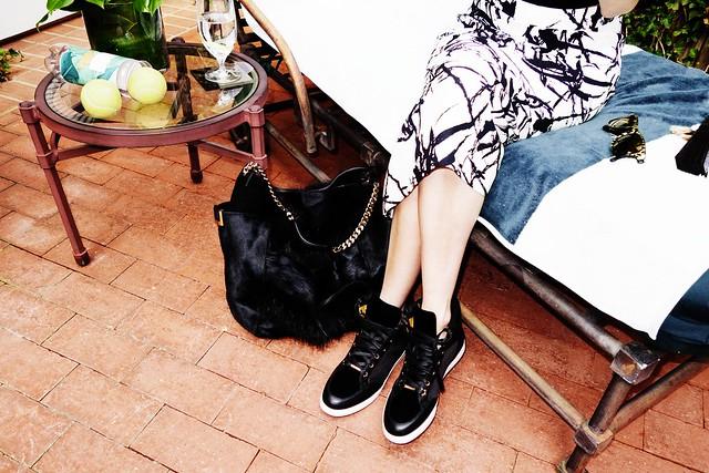 Emma Roberts wears Tokyo & Anna bag