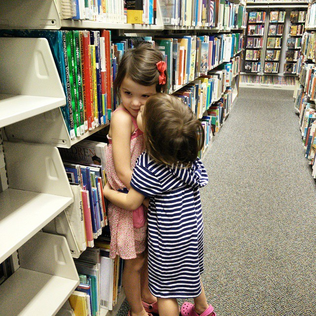 Spent the night hanging out at the library... Two minutes after this picture was taken, Fiona triggered the alarm by opening the emergency exit and we almost got kicked out. #neveradullmoment #toddlerlife