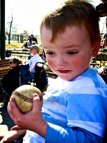 Holding his prized baseball from Coach Wade
