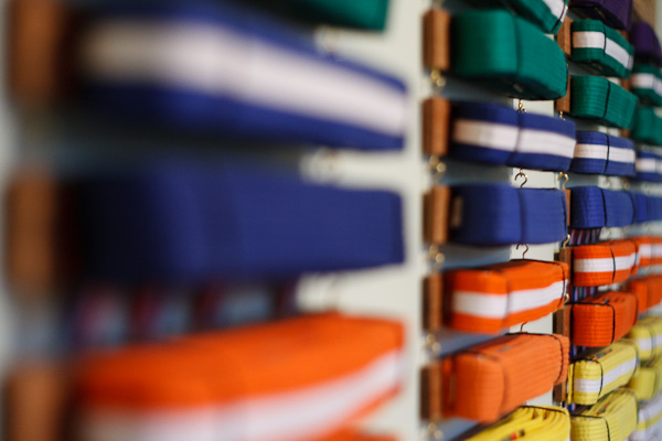 Several racks of Taekwondo belts.