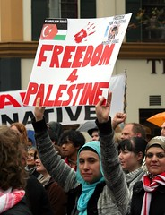 Woman holding placard - Freedom for Palestine