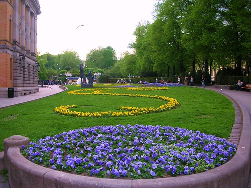 Pansies in fanciful decoration in beside National Theater