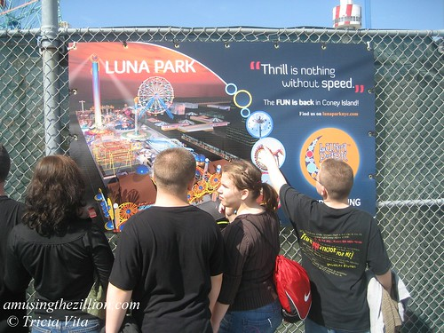 Children gather in front of banner for the new Luna Park. Photo © Tricia Vita/me-myself-i via flickr