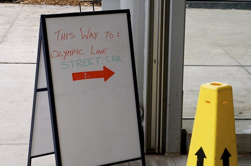 High-tech sign for Olympic Line at Olympic Village Station