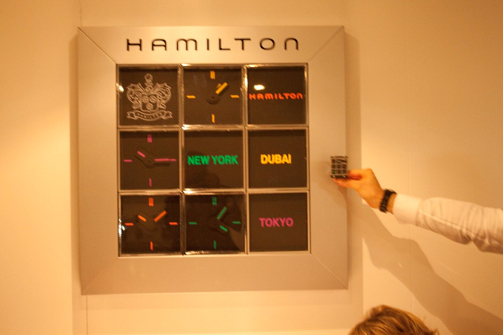 Hamilton Timeplayer wristwatch next to Timeplayer wall clock