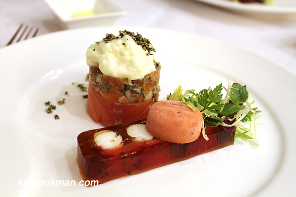 Lime Infused Confit of Norwegian Salmon, King Crab Terrine served with Watermelon Sorbet