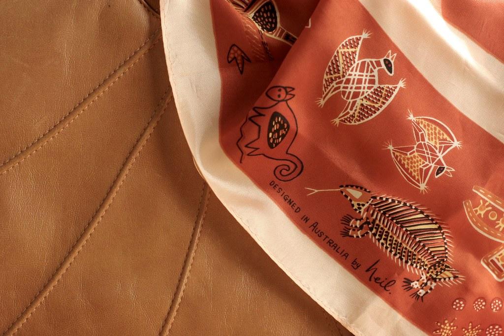 "Silk scarf with aboriginal Australian designs, ""designed by Neil"""