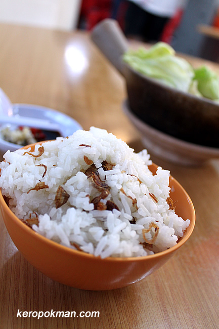 Rice with shallots bits.